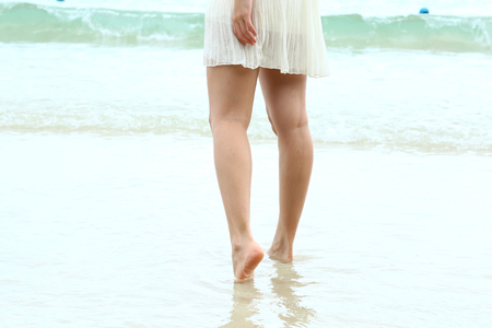 Asian woman white dressed at sea photo