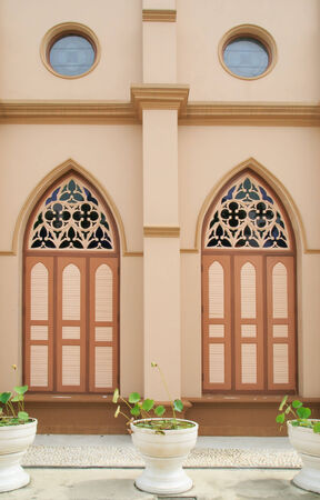 Two of brown wood church windows photo