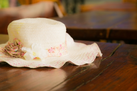 contryside: White summer hat on table