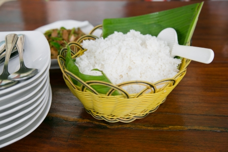 streamed rice in banana leaf rattan tray Stock Photo