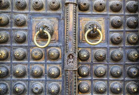 traditonal: Traditonal gold metal door Stock Photo