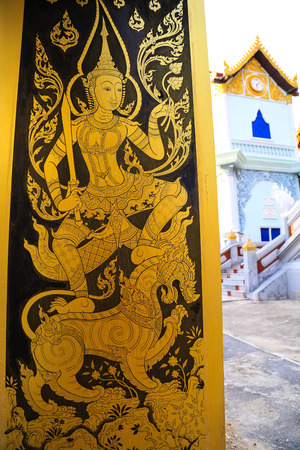 Traditional Thai gold painting on temple door photo