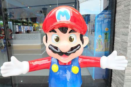 mario: Bangkok, Thailand - JUNE 19, 2015: giant Super Mario statue in front of a video game center at Paseo Plaza Mall