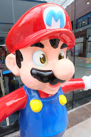 Bangkok, Thailand - JUNE 19, 2015: giant Super Mario statue in front of a video game center at Paseo Plaza Mall