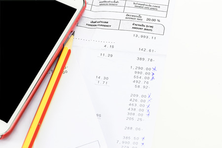 pencil and mobile phone are on bill