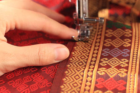 Sewing Thai cloth by sewing machine 스톡 콘텐츠