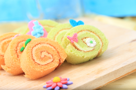 sugar paste: orange and green roll with butterfly sugar paste
