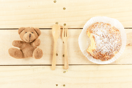 french fancy: utensil between bear and donut