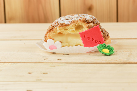 i love you sign: donut with icing on red cloth and I love you sign