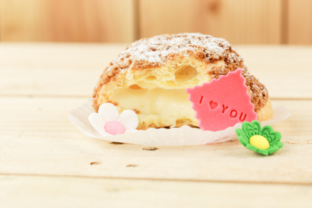 i love you sign: Close up bited choux cream and I love you sign