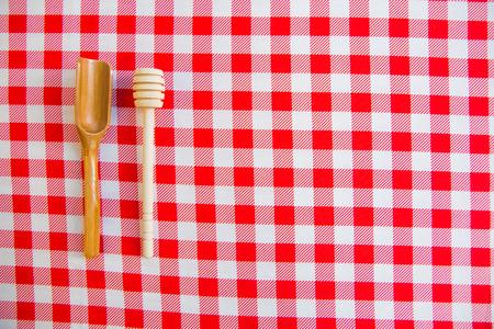 Tea spoon, kitchen utensil on red and white checker table runner