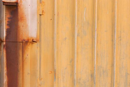 louver: Grunge yellow old shutter wall