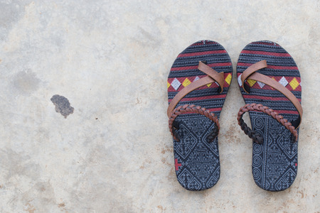 floor cloth: Traditional pattern cloth slipper on concrete floor