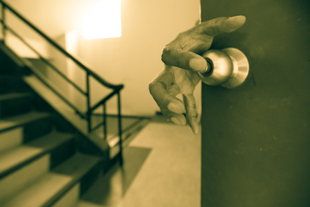 grabing: Dangerous hand grabing door knob as theif or murderer or ghost for scary theme Stock Photo