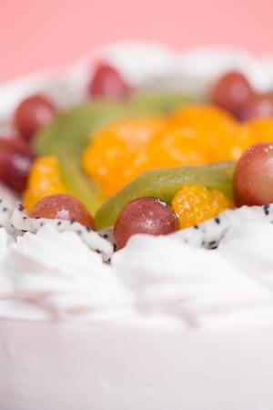 white cream fresh fruit cake for christmas Фото со стока