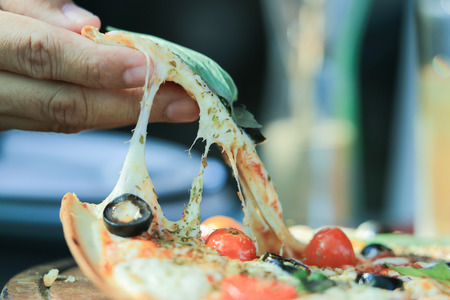 Anchovy think yummy pizza, Italian famous dish with salty fish, black olive, red cherry tomoto, permesan cheese and origano as ingredient