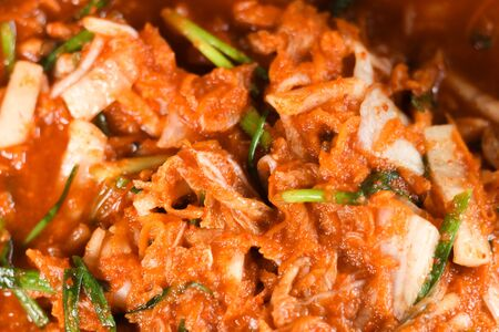 Kimchi,Korean cuisine famous side dish, traditional side dish and fermented vegetables, cabbage and radish, spicy and smelly seasonings including apple or pear, onions, garlic, ginger, spring, onion and mushroom.