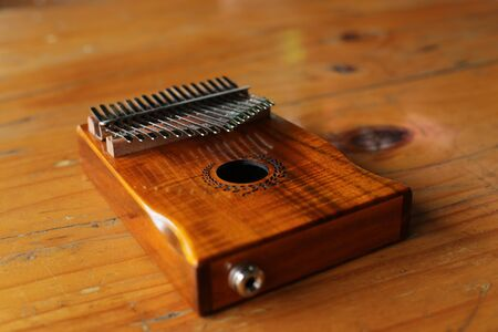 Kalimba or mbira is an African musical instrument.Traditional to the Shona people of Zimbabwe. Kalimba made from  wooden board with metal, play on  hands and plucking the tines with the thumbs Imagens