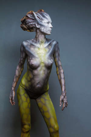 Body art is created in my private Studio for the conceptual case, the idea of animal fantasy woman dragon