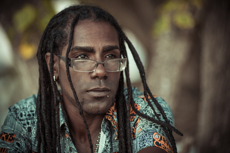 Ð¡onceptual portrait of black men with dreadlocks