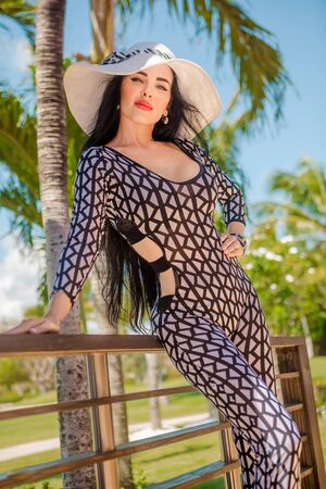 Sexy latina with long black hair in park and restourant Stock Photo