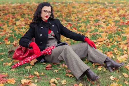 A beautiful woman in the autumn Park. Teachers day Stockfoto
