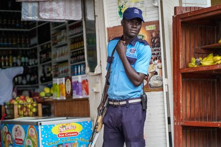 December, 2019. Africa, Uganda, scenes from African life, guy with a gun, in uniform of Sarasen Uganda, the new dimension in security