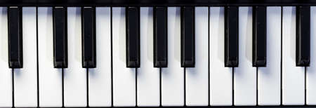 Top close-up view of keys of piano or keyboard