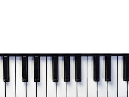 Top view of piano or keyboard in white background