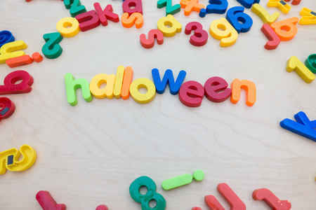 Colorful word halloween  on wooden table with copy space