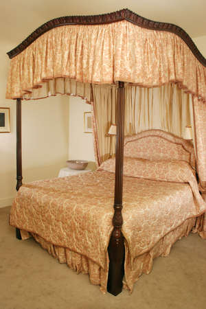 four poster bed: Luxury Four Poster Bed in mansion Hotel Stock Photo