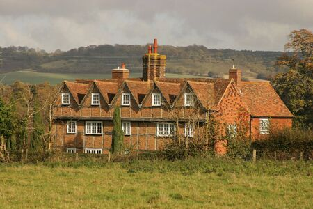 gables: Red Brick House with gables and chimneys in English countryside Stock Photo