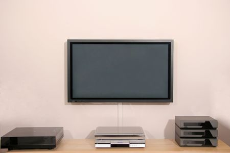versatile: 42 inch Hi Resolution Home Cinema Plasma display and audio equipment Stock Photo