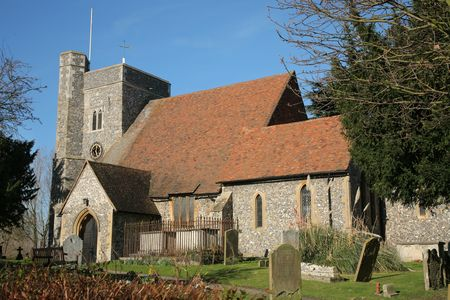ecclesiastical: Historic ancient english flint stone church with steeple Stock Photo