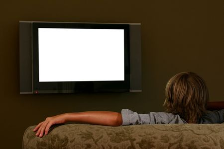 boy watching flat screen television/blank screen Stock Photo - 229180