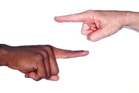 accuse: two hands of different races pointing at each other