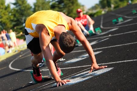 A runner is in the starting blocks ready to run a race