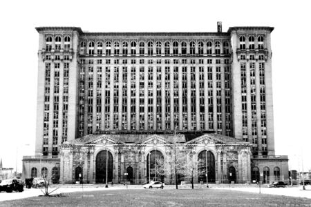 A black and white photo of the Detroit Railroad Station the image is isolated