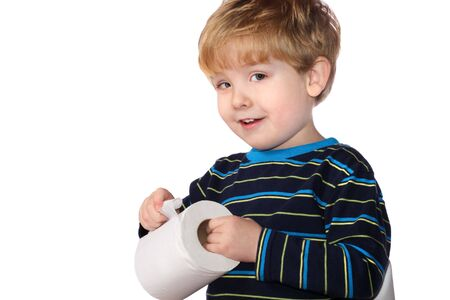 toilet: a young boy holds a roll of toilet paper Stock Photo