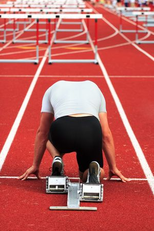 hurdles: A man is in the starting blocks ready for a race Stock Photo