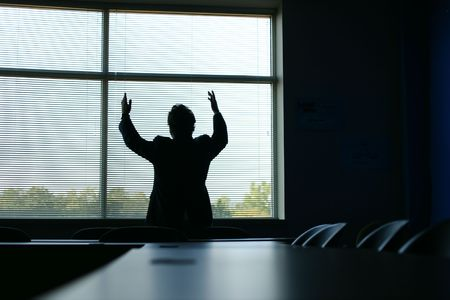 Silhouette of businessman with hands in the air in triumph photo