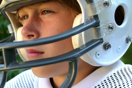 youth football: Close-up of a teenager in a football helmet  Stock Photo
