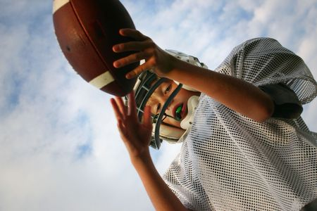 A teenager holding a football ready to kick it Stock Photo - 2758240
