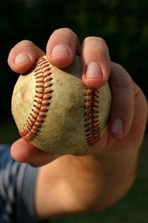 shortstop: Closeup of mans hand ready to throw a baseball Stock Photo