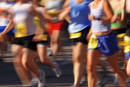 Runners streak past the camera in a marathon Stock Photo - 2756336