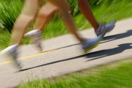 Two runners jog on a path -- they are motion blured to emphasize their speed Stock Photo - 2756319