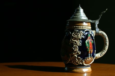 stein: A traditional German beer stein with very dramatic lighting Stock Photo