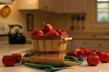 bountiful: Bushel basket of apples on a kitchen counter