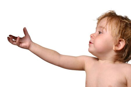 Isolated picture of a toddler holding out his hand.  Hand has a shadow of an object on it.