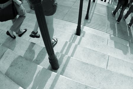 foot path: a close up of people are walking down a concrete stairway Stock Photo